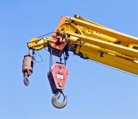 maneuverable: automobile crane with blue sky