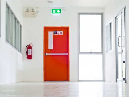 fire safety: Building Emergency Exit with Exit Sign and Fire Extinguisher.