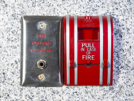 fire fighter: fire fighter telephone and fire alarm Stock Photo