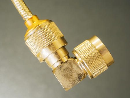coax: brass N-type connector in head of coaxial cable Stock Photo
