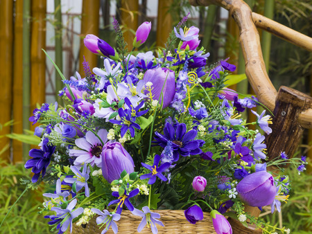 artificial flowers: colorful artificial flowers on basket Stock Photo