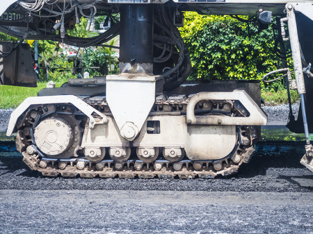 asphalting: compressing of roller machine during road construction at asphalting work