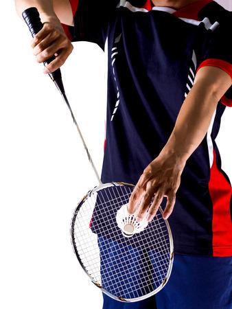Hand der Badmintonspieler mit Schläger und Federball