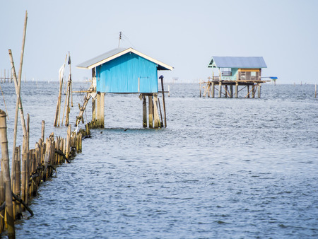 a hut on the sea, it build for protection of the farming seashell and oyster from the theif, now aday also to use as home stay activity.