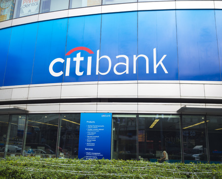 bank branch: BANGKOK, THAILAND - DECEMBER 13, 2014: Citibank sign installed outdoor. Citibank is a banking division of financial services multinational Citigroup, founded in in 1812 as the City Bank of New York.