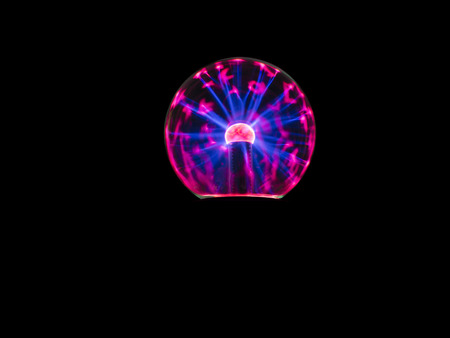 electrons: electric spark on plasma ball , the high voltage supply to inner electrode then electrons discharge through low pressure gas to outer sphere