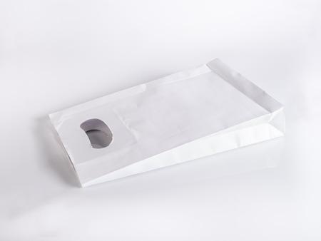 white paper bag: white paper bag on white background