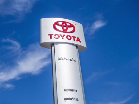 CHEANGMAI, THAILAND - JANUARY 15, 2015: TOYOTA logo installed outdoor to indicate the sale and service center. TOYOTA is Japaneses car mauafacturer which sold around the world. Editorial