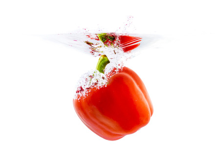 bell peper: red bell pepper dropping in water surface