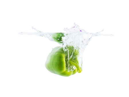 bell peper: green bell pepper dropping in water surface