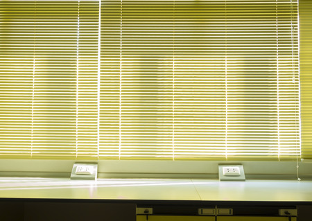 window curtains: vertical blind in use to block sun light