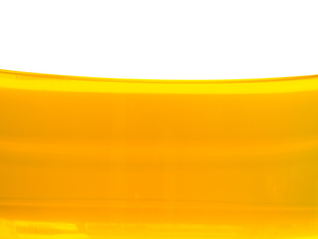 splash mixed: abstract background of yellow oil in the beaker Stock Photo