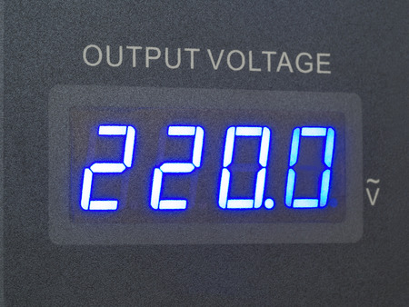 volts: voltage output of measurement in supply source showing 220.0 volts Stock Photo