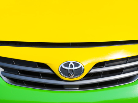 BANGKOK, THAILAND - MARCH 07, 2015: TOYOTA logo on the front of a car. TOYOTA is Japaneses car manufacturer which sold around the world.