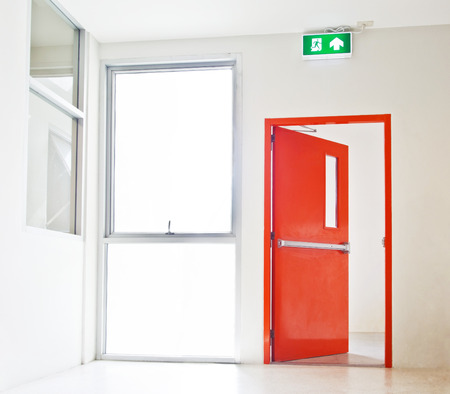exit: Building Emergency Exit with Exit Sign, red door opening to white