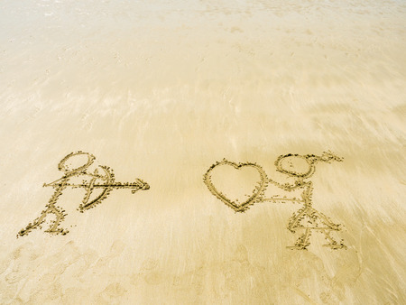 sand writing: the symbol of buddy love writing on sand in the sea beach Stock Photo