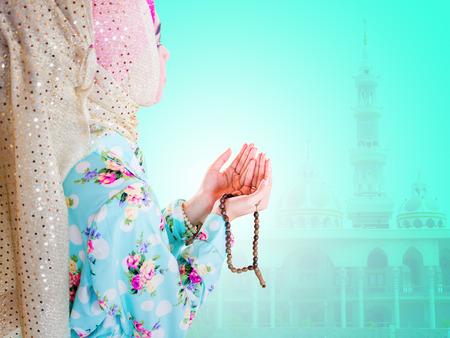 muslim prayer: young muslim woman praying for Allah, muslim God Stock Photo
