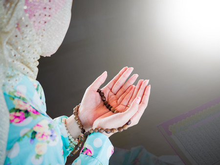 young muslim woman praying for Allah, muslim God Standard-Bild