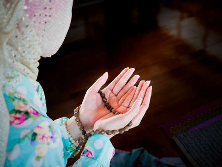 islamic pray: young muslim woman praying for Allah, muslim God Stock Photo