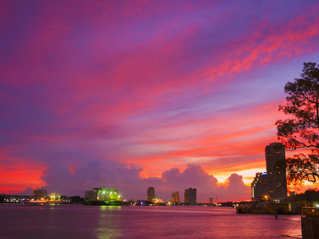 river side: colorful cloudscape on the river side of city skyline Stock Photo