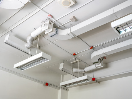 fluorescence: fluorescence lamp installed on ceiling,showing tube line and ventilating system Stock Photo