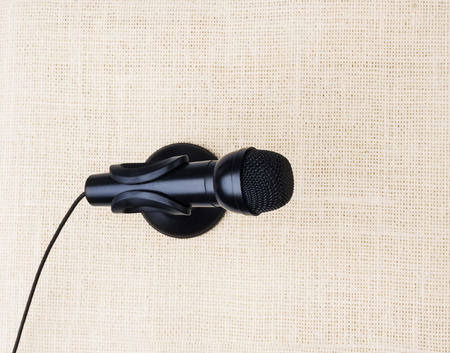 easier: black microphone on cloths background, electronic microphone makes sound recording easier.