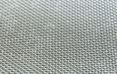 metalic texture: selective focus on stainless metal mesh, metalic grid texture pattern background Stock Photo