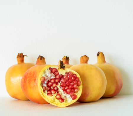 tannin: ripe Pomegranate on white background, fruits rich of vitamin especially tannin which help in free radical therapy