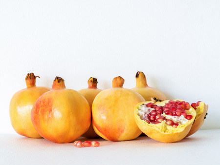 especially: ripe Pomegranate on white background, fruits rich of vitamin especially tannin which help in free radical therapy