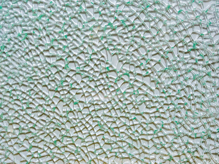 tempered: cracked pattern on broken glass (tempered type) showing random fracture line