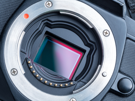 ccd: cmos sensor or also called digital ccd installed on mirorless camera, showing red polarized filter on the top