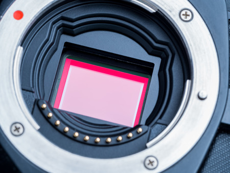 cmos: cmos sensor or also called digital ccd installed on mirorless camera, showing red polarized filter on the top