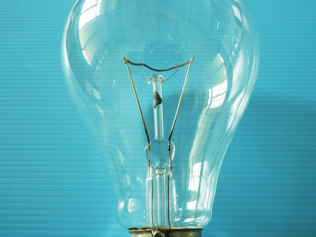 electric current: close up of element in the incandescent light bulb, showing wire which electric current flowing in the tungsten filament