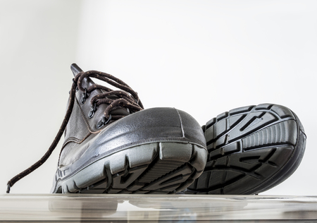 safety boots: safety boots with reinforced head for wear in the risk  area Stock Photo