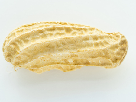 monkey nuts: macro shot on peanut shell on white background, stacking focus Stock Photo
