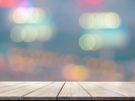 wooden floor: Blurred city background, with wooden floor Stock Photo