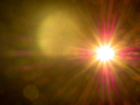light source: optical lens flare in the dark from the light source reflected within the glass