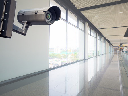 Security CCTV camera or surveillance system in modern office building Stock Photo