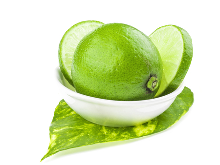 focus stacking: green lemons on dish, lemon is a sour juicy fruit, stacking focus added Stock Photo