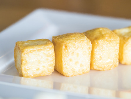 bean curd: boiled bean curd in cubic shape ready to serve on white dish