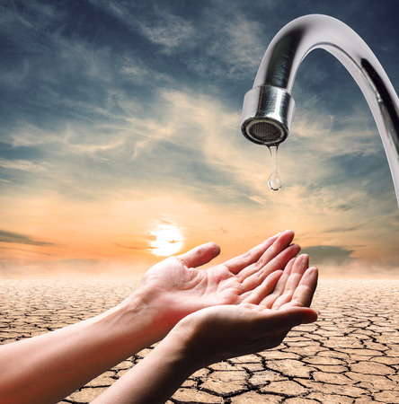 lack: water drops from faucet which lack of water,expression on EL nino climate effect Stock Photo