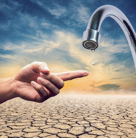 lack water: water drops from faucet which lack of water,expression on EL nino climate effect Stock Photo