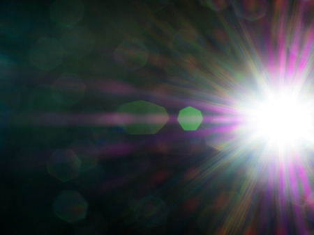strong light: Lens flare of strong light source in the dark, abstract background