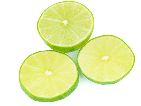 sliced green lemons, lemon is a sour juicy fruit, stacking focus added Stock Photo