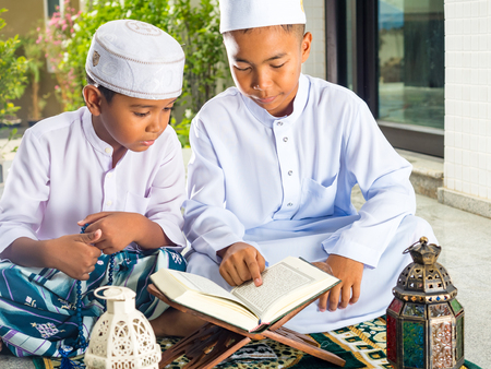 muslim children read the holy Quran(the public item of all muslims ). Stok Fotoğraf