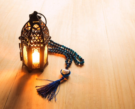 candle light on muslim style's lantern shining on arabic letter of the name of God