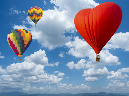 cloud scape: beautiful cloud scape on blue sky background over top mountain view with hot air balloons