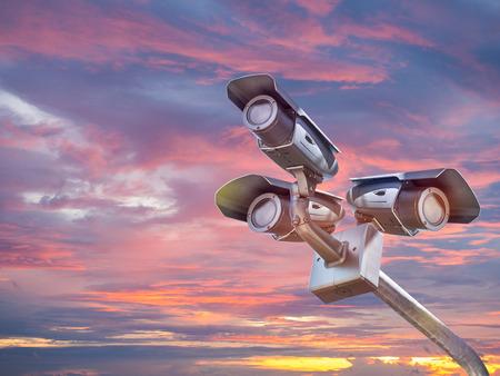 CCTV camera or surveillance system on blue sky background