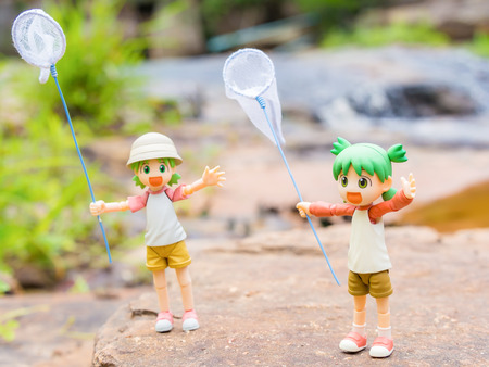 BANGKOK, Thailand - July 30, 2016 : Yotsuba anime figure placed on outdoor nature with net on hand. Yotsuba models are also popular in asia.