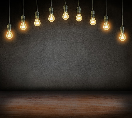 incandescent: electrical incandescent lamp glowing on dark background Stock Photo